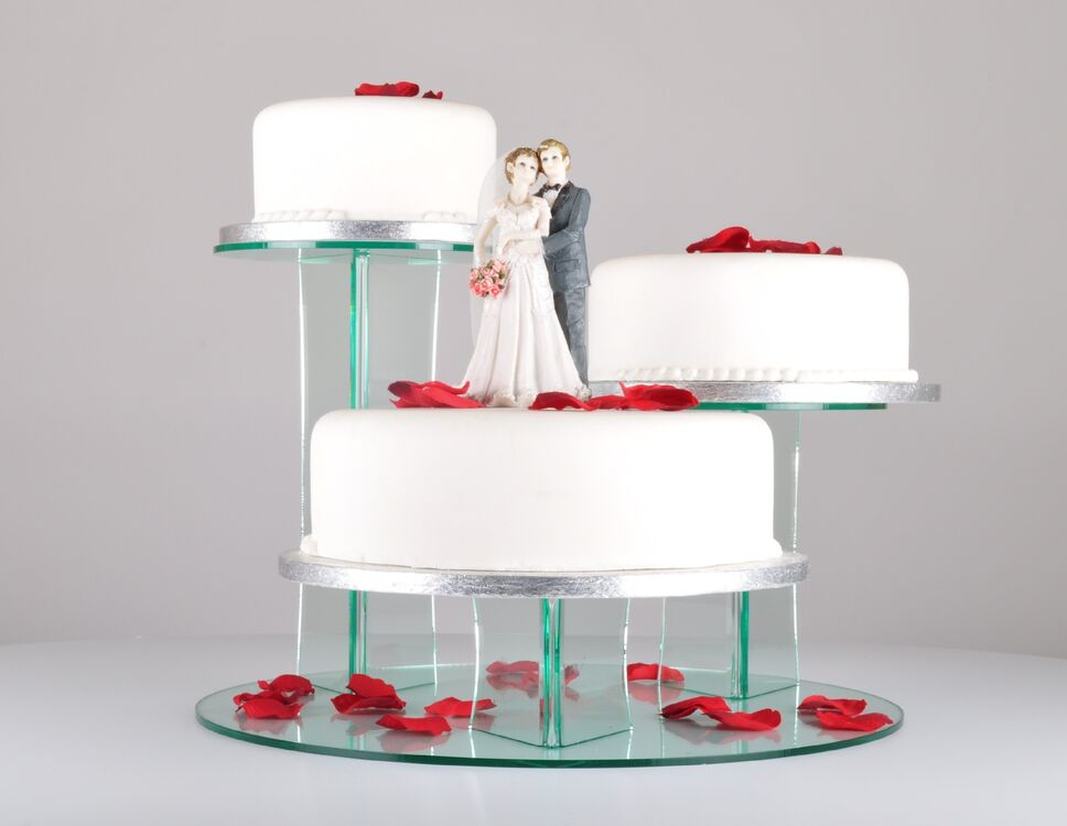 Three Tiered Cake Display Stand Is Stood Upon A Sturdy Round Base
